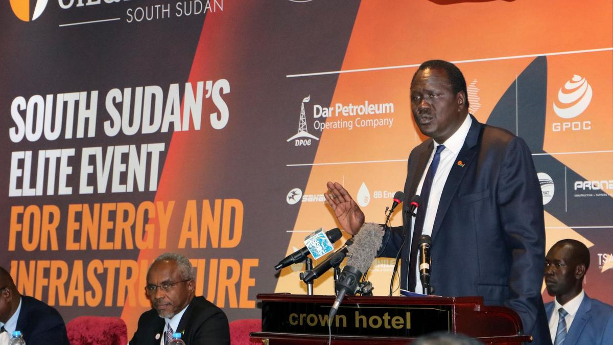 South Sudan's petroleum minister Ezekiel Gatkuoth welcomes potential investors during the second Africa Oil and Power conference in Juba (AP)