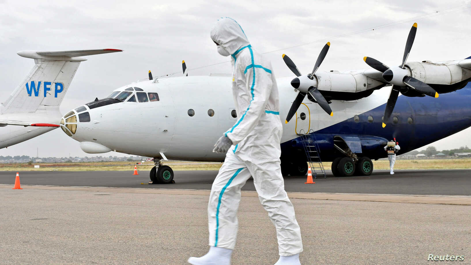 A member of a medical team wearing a protective suit cleans the airfield to prevent the spread of COVID-19 at the Juba International Airport in Juba, South Sudan, on April 5, 2020 (Reuters/VOA)