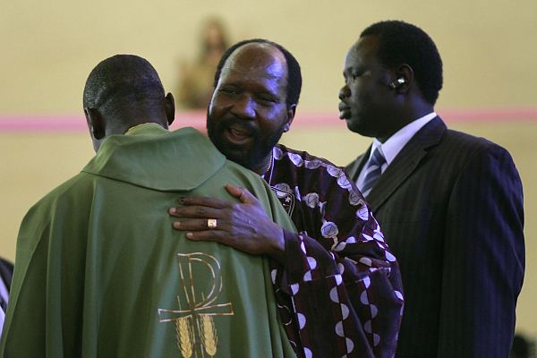 South Sudanese President Salva Kiir, center, hugs Catholic Archbishop Paulino Lukudu following a church service at Juba, Southern Sudan on Jan. 16, 2011 (Copyright CSM)